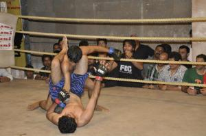 Aditya Deshpande goes for an armbar in his 135-lbs tilt with Sagar Kadu at FCC 7
