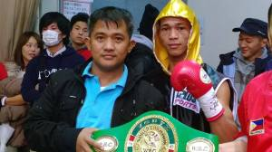 Brico Santig (left), Loreto's manager with another Filipino boxer