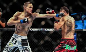 Will Chope with a stiff jab thrown at Max Holloway in their 145-lbs tussle at UFC Fight Night 34.