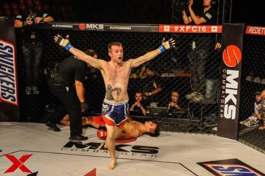 "Courtesy of XFC; James Gray puts Lucas ""Treta"" to sleep"